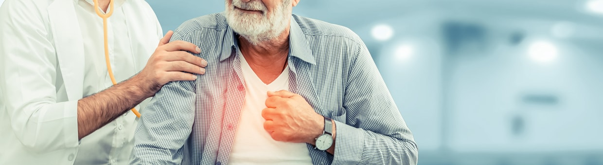 An elderly man seated for a checkup