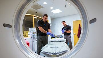 technicians with mri machine