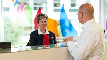 concierge helping a man at the service desk