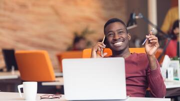 satisfied employee smiling at his desk