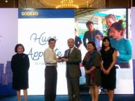 Johnpaul Dimech, Region Chairman of Sodexo Asia Pacific receives the Champion of Good award from Singapore's Minister of Finance, Mr Heng Swee Kiat.